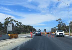 Highways Traffic conducting traffic management on Reid Highway in WA